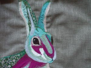 An embroidered Cushion Cover